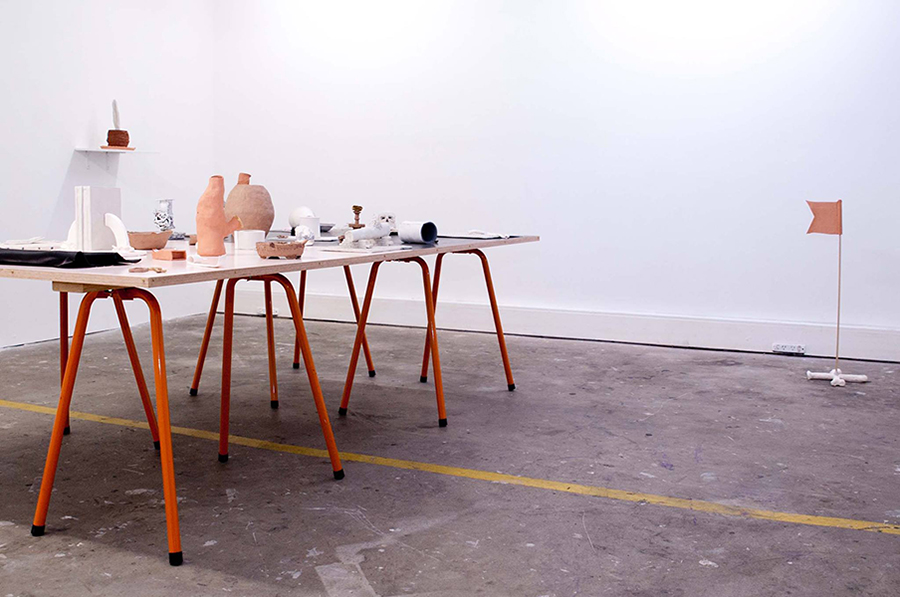 Christopher Dolman. Other Day Ornamental 2014. A collaborative project with Paul Williams. Underglaze and enamel on fired and unfired clay, acrylic and stain on marine ply, metal trestles. Dimensions variable. Installation views Alaska Projects, exhibited as part of SafARI 2014. Image credit: Lara Merrington