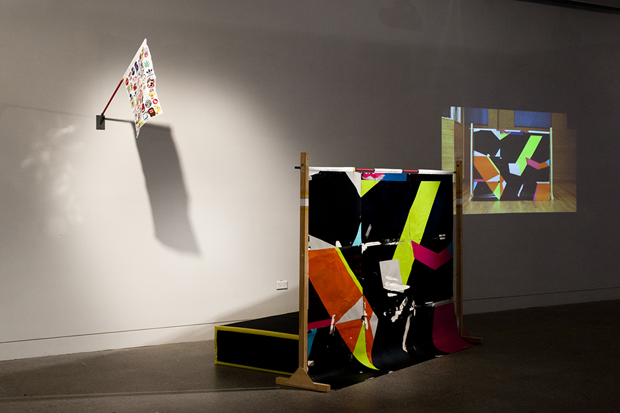 Christopher Dolman. Jumprint 2013. Mixed media on paper mounted on paper, enamel and tape on metal pole, IKEA clothes rack, cut foam, bed linen. Digital video projection 5min looped. Dimensions variable. Installation views Hazelhurst Regional Art Gallery. Image credits