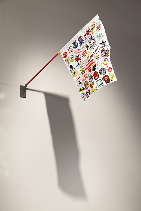 Christopher Dolman. Sponsors Flag 2013. Stickers on cotton, acrylic and cloth tape on wood, steel.
