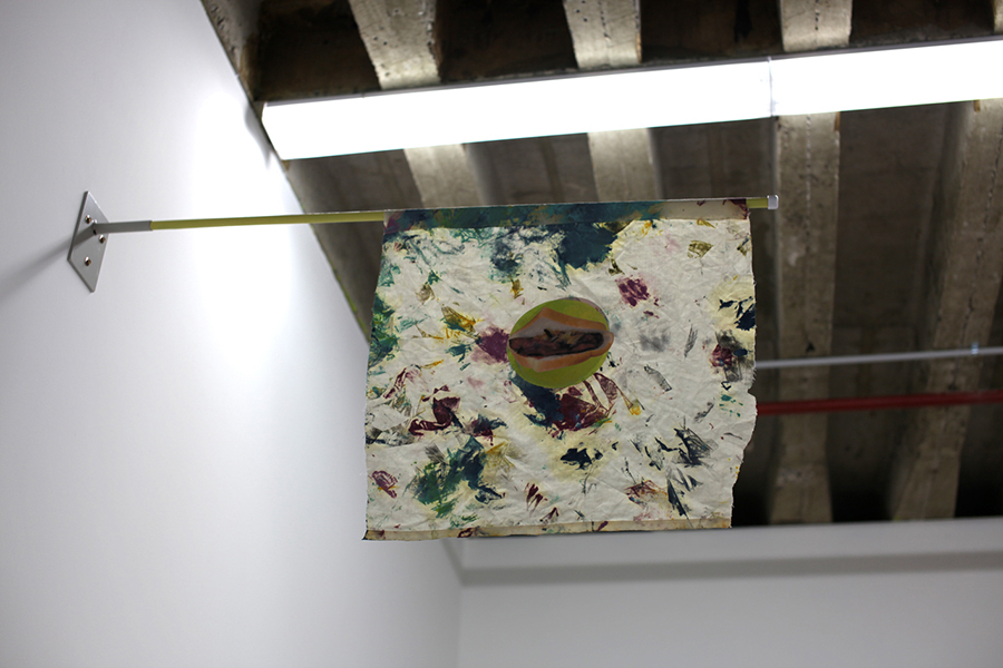 Christopher Dolman. <em>Rag Flag</em> 2012. Oil, ink and paper collage on cotton, acrylic on wood, steel. 50x60x05cm