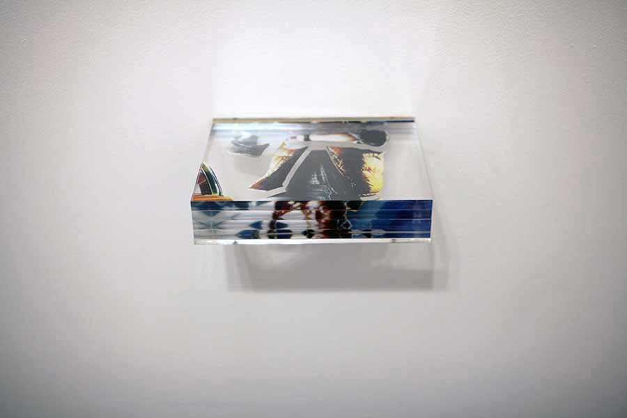 Christopher Dolman. <em>Trapped in the future</em> 2012, digital print and cut perspex. 20X08x15cm